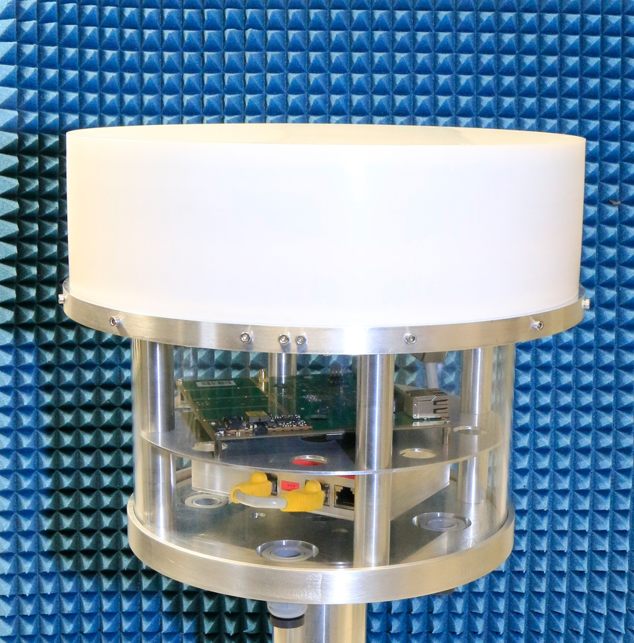 The Q-band prototype with housing for the communications and control electronics below the antenna.